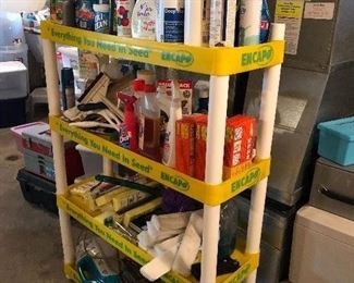 cleaning, paint, household items on vintage garden store shelf