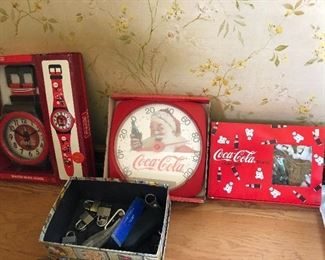 more new in box Coke clocks and thermometers