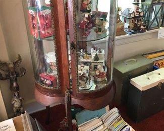 quatrefoil glass curio cabinet