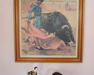 "Living Room:  ""Ole!""  The vintage bullfighting scene with the matador and bull is replicated in the two-piece ceramic figure set just below it."