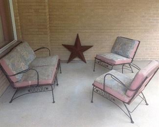 Patio:  The four-piece Mid-Century Modern  patio furniture needs a little TLC but is still very usable and desirable.  There are actually four separate chairs (three have arms) that can be configured in different ways.  The rusty star is also for sale.