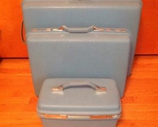 Bedroom:  This set of Mid-Century Modern 3-piece sky blue/turquoise SAMSONITE luggage is in  VERY good condition!