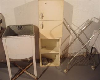 Basement:  A vintage wash tub; two stacked metal cabinets, and a rolling rack are all for sale.