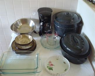 Kitchen:  Ceramic dishes, Pyrex, a black SUNBEAM electric coffee pot, a 3-piece black granite ware canning pot, a roaster, and more are all for sale!