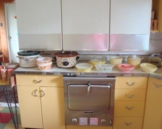 Kitchen:  A closer view of newer crock pots and vintage dishes (including Fire King and Pyrex).