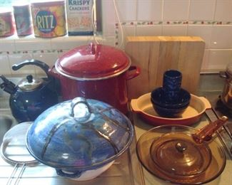 Kitchen:  Yes, more!  Including a red PAULA DEEN stock pot; a LeCreuset oval pan; vintage VISIONS cookware; and a large pottery bowl/lid.