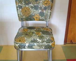 Kitchen:  Shown is one of the four kitchen chairs.  A side view of the interesting legs follows.