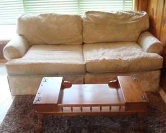 "Family Room:  A newer cream color sofa with two seat cushions and rolled arms measures 86"" long.    Closer photos of the table and rug  follow."