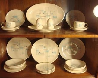 "Dining Area:  The 1950's FRANCISCAN ""Atomic Oasis"" china includes:  one platter, four dinner plates, four salad plates, four dessert plates, four cereal bowls, two cups, four saucers, and a set of salt & pepper shakers.   It is priced out (not priced as a set)."