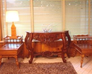 Family Room:  A pair of hard rock maple side tables with hinged top drawers and a vintage lamp flank a carved wood console table and punch bowl set.  The side tables are priced as a pair but there is also a matching coffee table coming up.  A closer photo of the carved wood table follows.