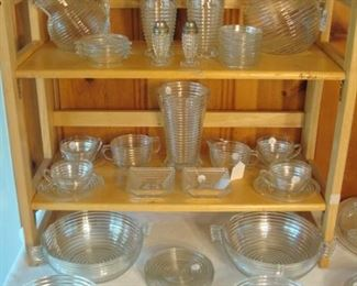"Family Room:  The ribbed ""Manhattan"" glass includes:  water and juice pitchers; tumblers; salt & pepper set; cups & saucers; cream & sugar; winged bowls; ashtrays; candle holders and more!    Each piece is priced OR priced as a set (e.g., set of coasters; per bowl; per dinner plates) so you can complete your current collection without having to purchase multiples."