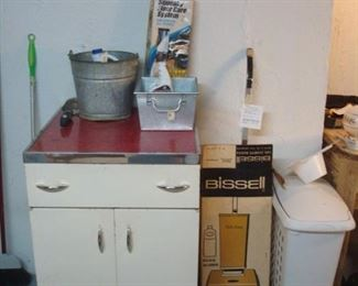 Lower Level:  A vintage metal cabinet and other miscellaneous items are all for sale.