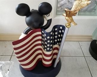 """BFIG-4 ($75) Disney Big Fig Mickey Mouse saluting the American Flag.  Stands 22"""" tall x 13"""" diam.  Mickey comes off, flag is stationary.   Great condition!"""