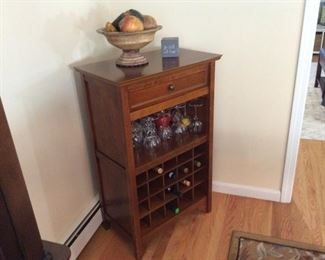 Wine and Liquor Cabinet (with storage draw)            Perfect Condition, Really Nice Piece:  $195.00       Contact Mary: 401-996-0612  or  macrowshaw@cox.net Anne: 401-935-2490
