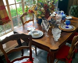 The table and one of the six side chairs