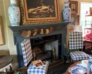 The fireplace mantel flanked with a pair of 20century temple jars and an original oil painting in an antique plaster frame. Other beauties abound!