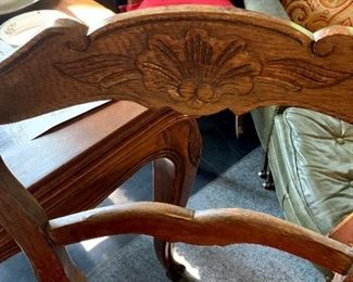Detail of the hand carving on the back of the chair