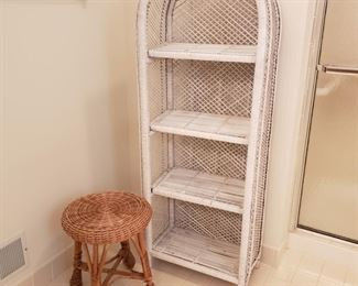 """Pair of wicker pieces. Stool is 18"""" high and rounded shelving piece is 57"""" tall."""