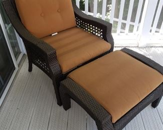 """Resin Patio  chair and ottoman with cushions. When measured together...50"""" long x 27.5"""" wide x 30"""" high. Some fading in cushions."""
