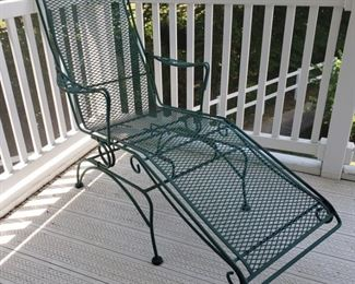 "Green iron ""rocking"" lounge chair with dogwood pattern. 60"" long x 26"" w x 41"" high."