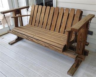"""Wooden swing chair. 64"""" wide x 27"""" deep x 32"""" high."""