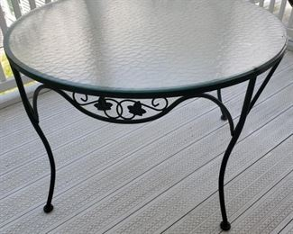 """Green iron table with ivy leaf pattern and bubble glass.  41.5"""" diameter x 39"""" high."""