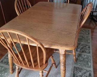 """Kitchen table with leaf. 59"""" long x 36"""" wide."""