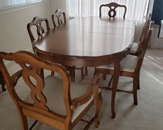 """Dining Room table and chairs. Six chairs, two with arms.  Table with one leaf  73"""" long x 41"""" wide x 29"""" high. Chairs measure approximately 37"""" high x 20"""" deep x 23 wide."""