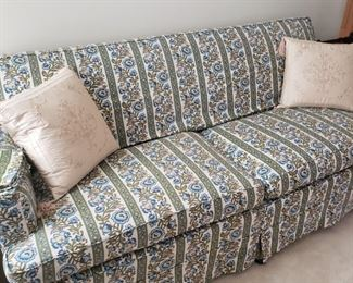 """Floral upholstered couch. Some signs of wear due to regular use. 34"""" deep x 32"""" high x 74"""" wide."""