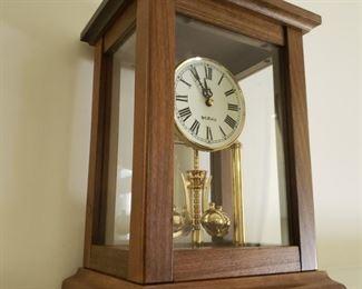 "Mantle clock. 8.5"" wide x 11.5"" tall x 7"" deep."