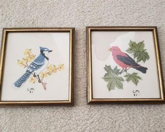 "Each piece of framed needlework is 8"" x 8"""