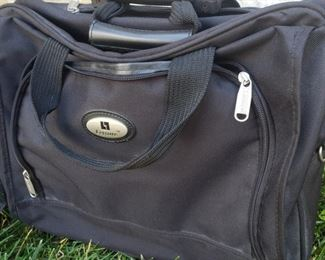 """Leisure Brand rolling briefcase with retractable handle. 13"""" x 17"""" x 6.5"""""""