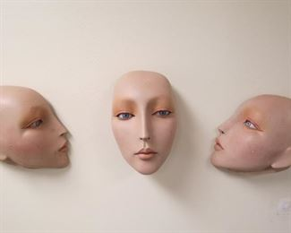 Vintage wall hanging mannequin faces.