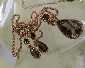 Gold filled pendant necklace with pierced earrings.