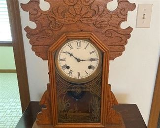 "Antique Gingerbread Waterbury clock from the 1800's Dimensions 22""H x 15"" W x 4.5"" D; $250"