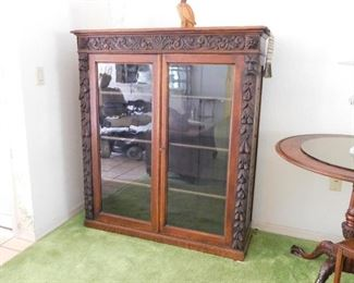 48 w x 53.5 t 13 d  Beautiful carved bookcase