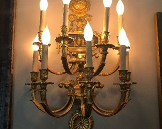 One of a Pair of Nine Light Bronze Sconces