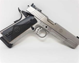 """225 Ruger SR1911 Target Model .45AP Semi-Automatic Pistol, No CA Transfer Includes box and lock. Serial Number: 673-11822  Barrel Length: 5""""  Out of state shipping available to your local FFL. Buyer is responsible for checking local laws before bidding. $25 shipping for a single handgun purchase with out insurance. Insurance cost varies by purchase amount. Shipping cost for multiple handguns or with rifles wil also vary."""