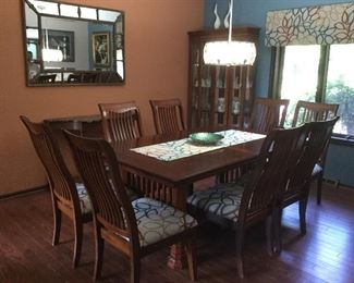 Very well made prairie style dining room set. Measures 72 inches long. Includes a 12 inch leaf and 8 chairs custom made runner included with set.