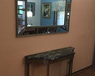 Beautiful large mirror and antique credenza with a marble top. Very well made furniture.