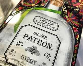 Collectible Patron Tin with the Bottle (sorry it is empty)