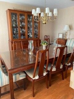 "6.       Rosewood Dining Room table from Okinawa with 2 leaves and 8 rosewood chairs & the 2 upholstery chairs $995.00.  Table has glass protectors  10'L w/leaves x 42""W  (7' w/o leaves)  7.       Rosewood china cabinet  5'L x 19""D x 82""H $595"
