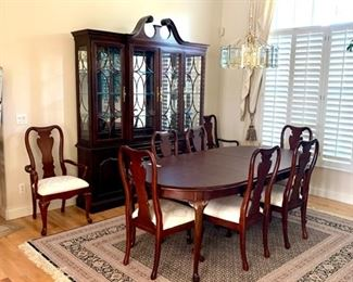 Shown here are the Gorgeous Thomasville Old Colony China Cabinet, Oval Dining Table and 8 Accompanying Chairs.