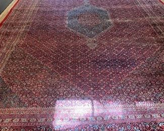 Huge Persian room-sized rug- hand-knotted in fine condition.  Clean example with a bold color palette and center cartouche