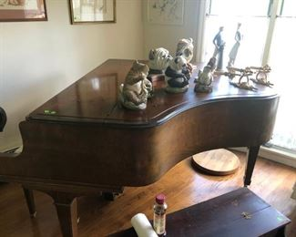 1952 Knabe baby grand piano with Boehm statues and other decoratives on it, including Lladro's.  A small corner of the small piano.  Hope we get its keys cleaned