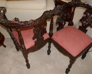 Tete a' Tete highly carved chair