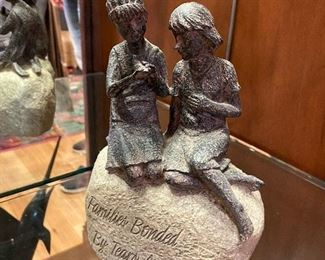 """Families Bonded by Tears and Laughter"" sculpture"