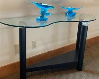 Contemporary glass table with black column legs and crystal ball top supports.  There's a pair of these.