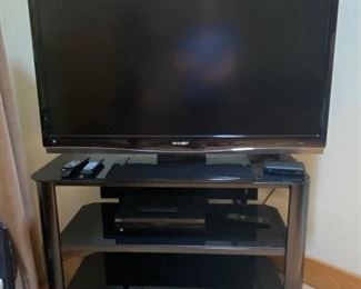 Flat screen TV and Innovex tempered glass audio/TV/media stand
