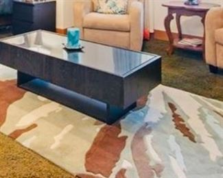 Contemporary black enameled coffee table and abstract rug